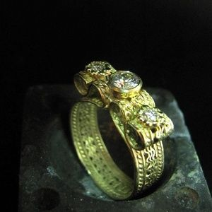 14k yellow gold engagement ring with diamons.